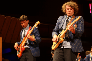 Two STC students playing electric guitar