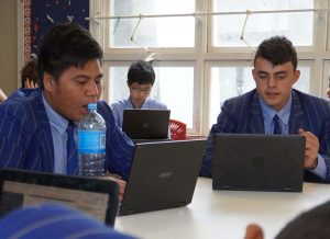 STC students seated at desks with open laptops
