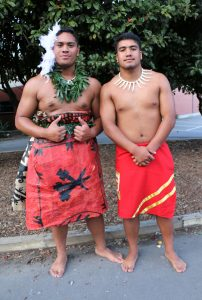 two males in traditional pasifika dress