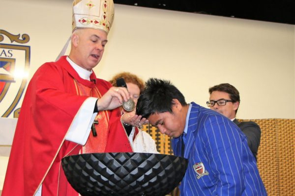 St Thomas of Canterbury College student being baptised