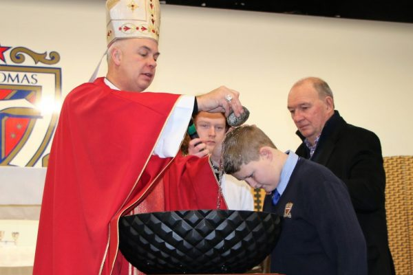 St Thomas of Canterbury College student being baptized