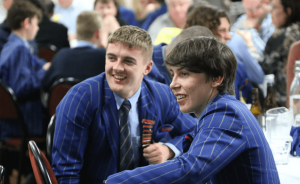 two St Thomas of Canterbury College boys laughing