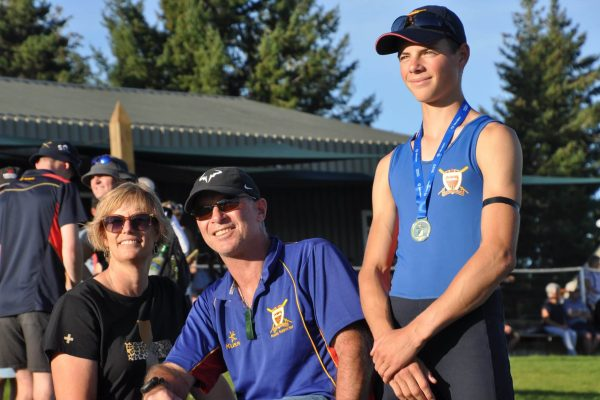St Thomas of Canterbury College rowing boy wearing a medal