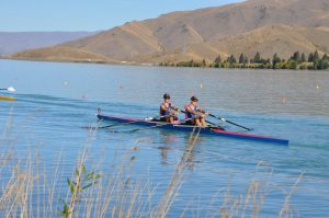 St Thomas of Canterbury College boys rowing on a lake