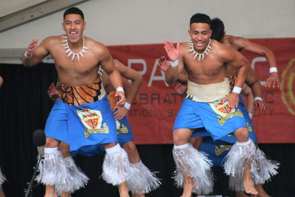 St Thomas of Canterbury College boys on stage wearing traditional dress for pollyfest