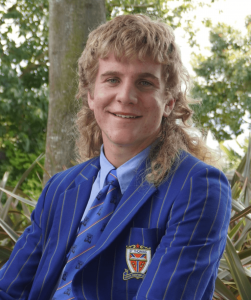 St Thomas of Canterbury College Head Captain in blue blazer and tie